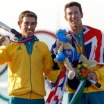 Australia's Mathew Belcher (L) and Malcolm Page pose with their gold medals for the men's 470 sailing class at the London 2012 Olympic Games in Weymouth and Portland, southern England, August 10, 2012.