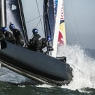 Team members of Full Metal Jacket Racing of New Zealand sail during the second day of the Red Bull Youth America's Cup Selection Series in San Francisco, California, USA on February 13, 2013.