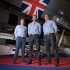 BAR team members Paul Goodison, Sir Ben Ainslie and Matt Cornwell stand in front of the J.P. Morgan BAR AC45 at the London Boat Show 2014, ExCeL, London.  Photo: onEdition