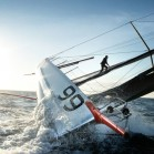 Alex Thomson walks the mast